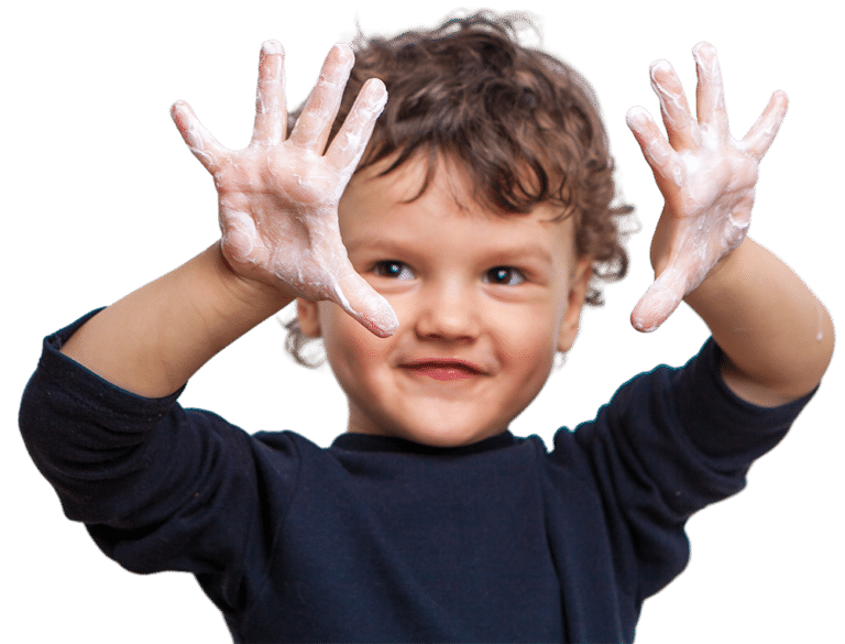 Boy washing hands at drop-in childcare center serving Washington and Texas